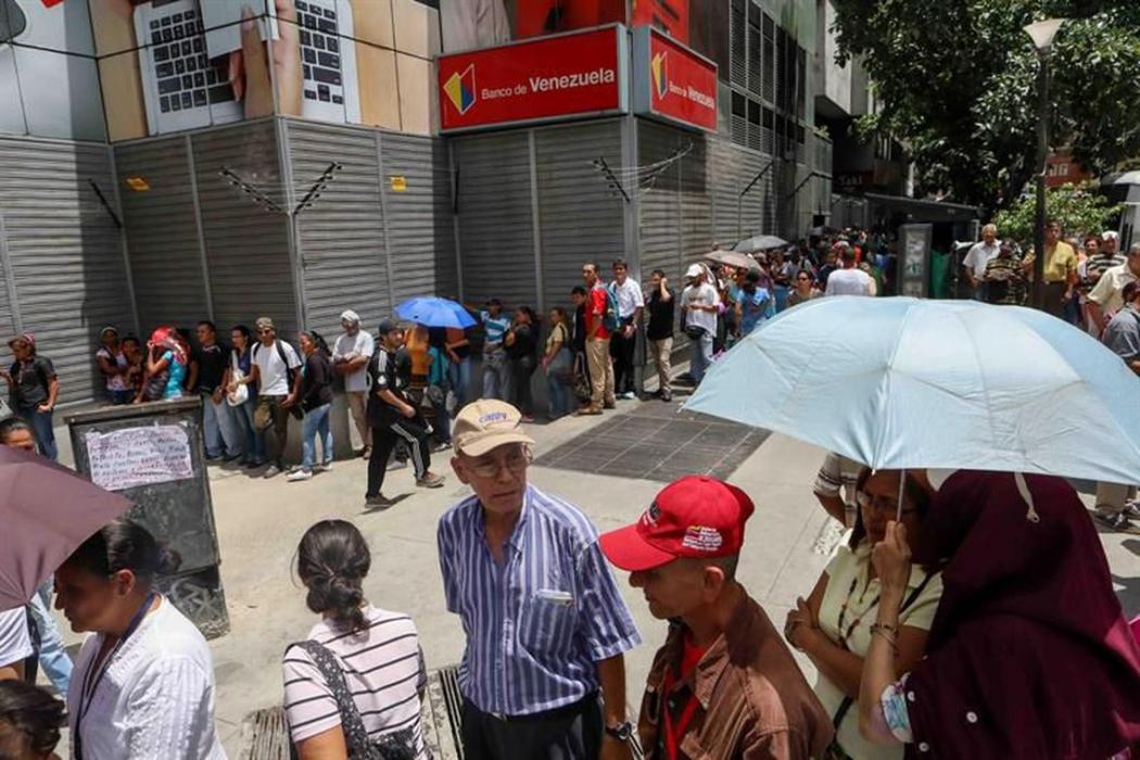 A população da Venezuela começou a usar moedas virtuais. Crédito: Cristian Hernandez/EFE/direitos reservados