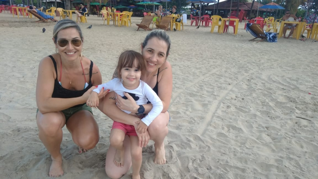 A advogada Patrícia Oliveira com a família na Curva da Jurema. Crédito: Caíque Verli