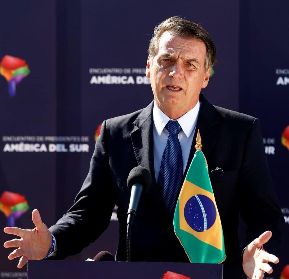 Jair Bolsonaro faz declaração em Santiago, no Chile . Crédito:  Esteban Garay/Reuters